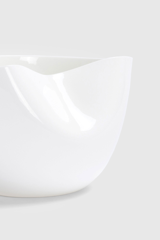 White Sculptural Fine Bone China Dented Bowl designed by Bodo Sperlein