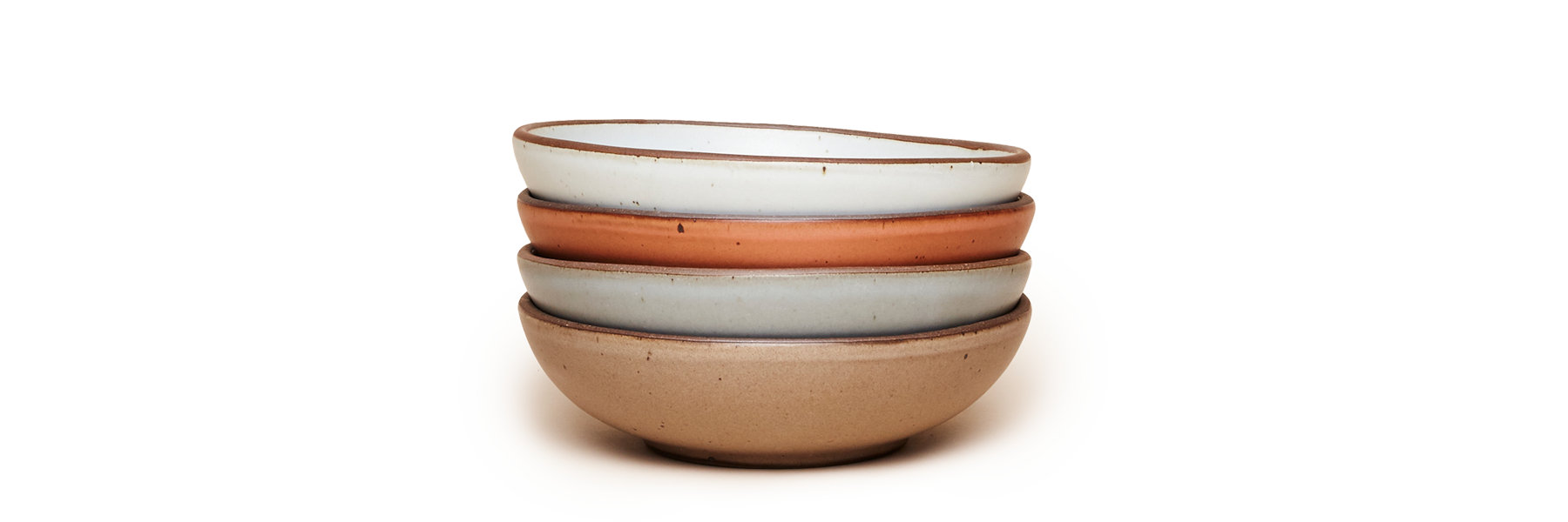 A stack of East Fork Everyday Bowls in a variety of colors