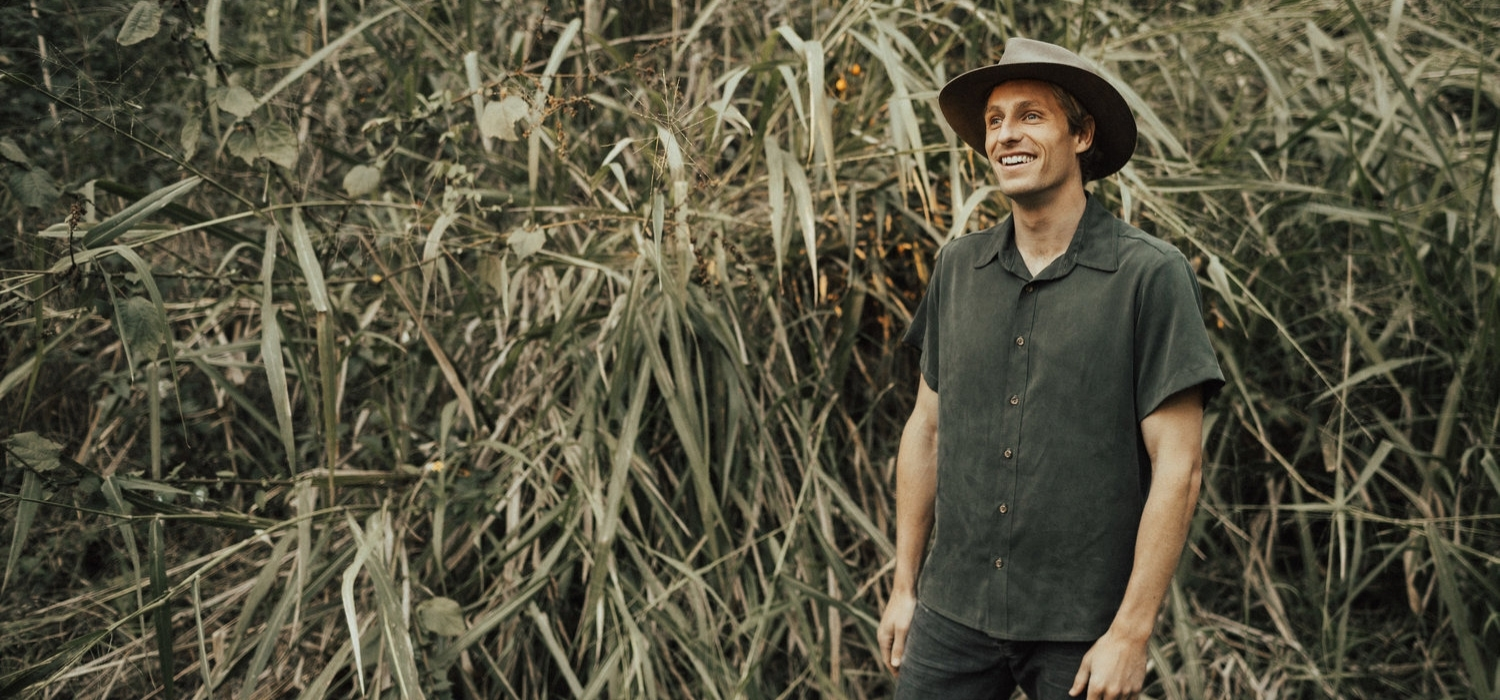 Tasi Travels' Men's Moss Short-Sleeve Voyager Shirt is handmade from sustainable Tencel