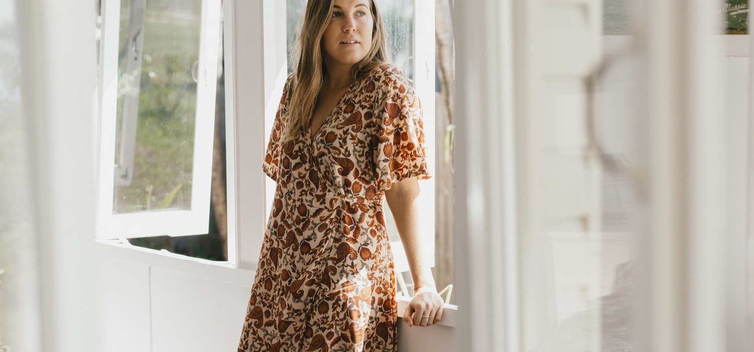 Tasi Travels' Native Paisley Print Wilder Wrap Dress is handmade from sustainable modal