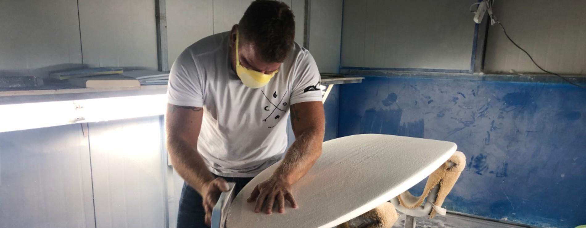 Ryan Briggs working on surfboard