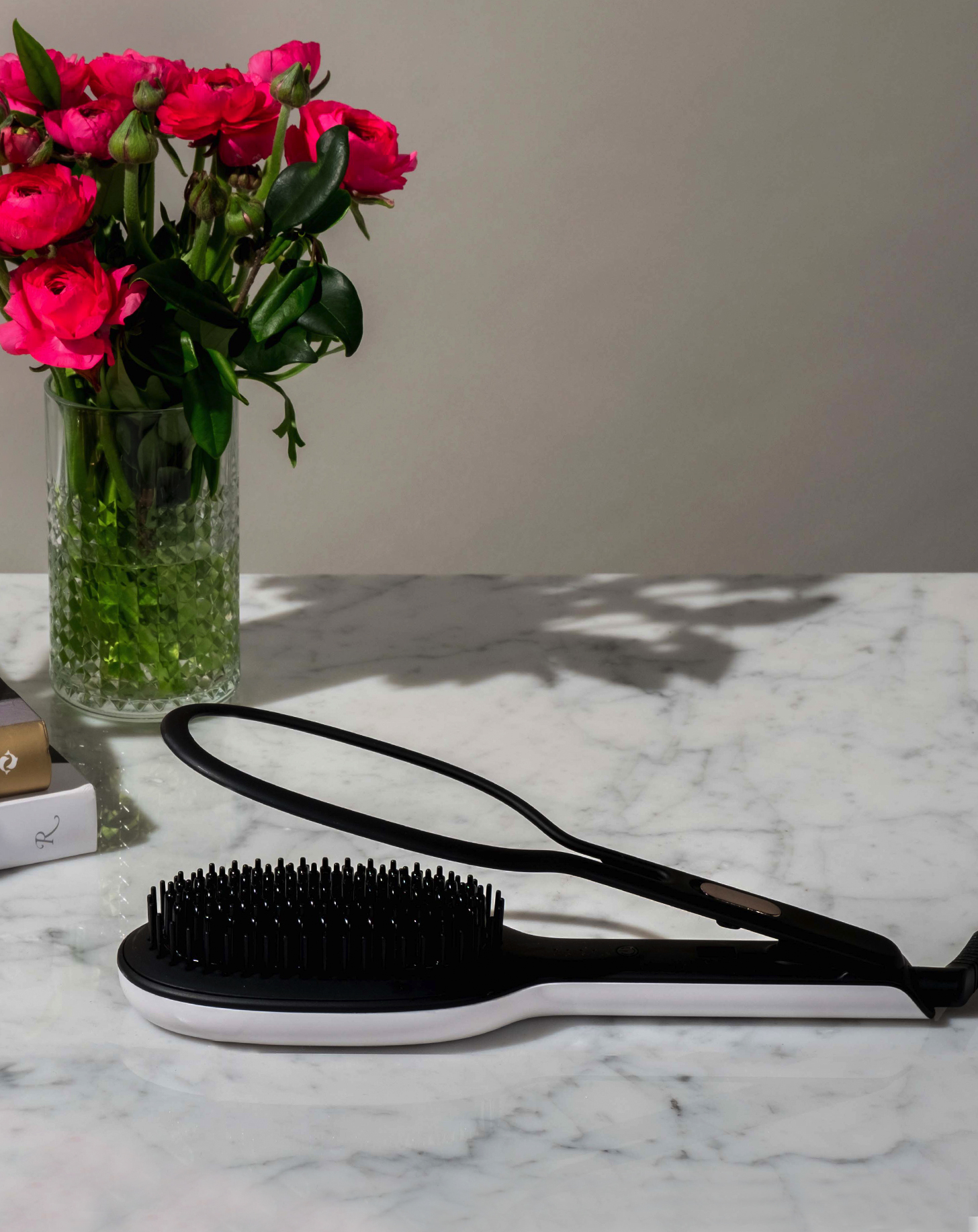 GLOSSIE Ceramic Styling Brush on marble counter