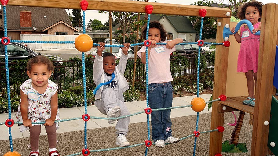 Community children play in totlot at Jamboree's Diamond in Anaheim, CA