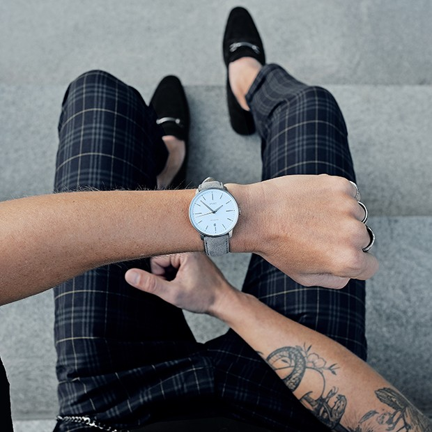 white, silver and grey leather watch on a mans wrist