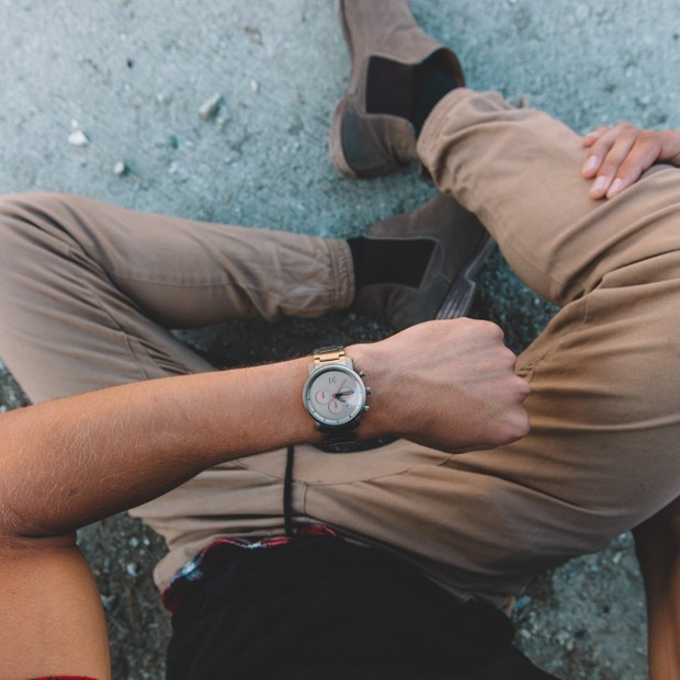 taupe stainless steel watch on a mans wrist