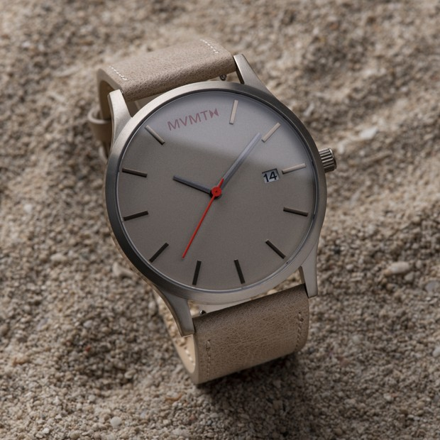 Taupe leather watch on a flat surface