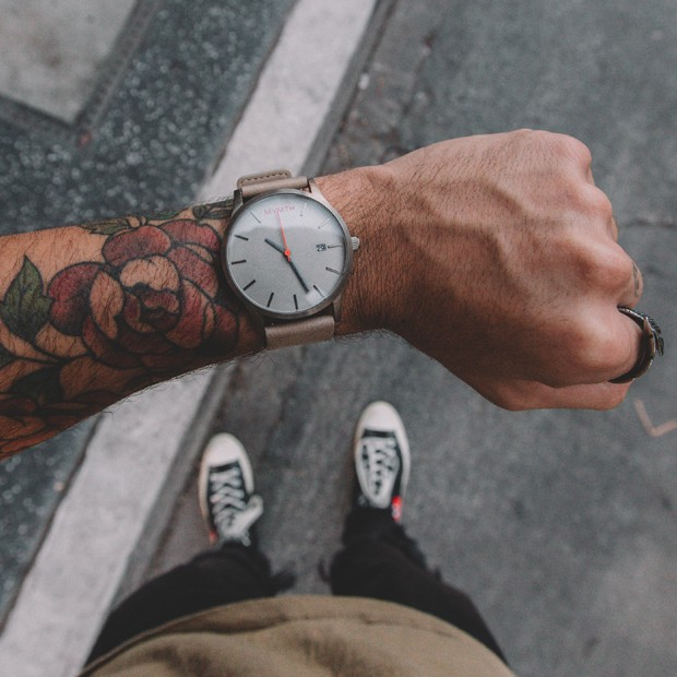 Taupe leather watch on a mans wrist