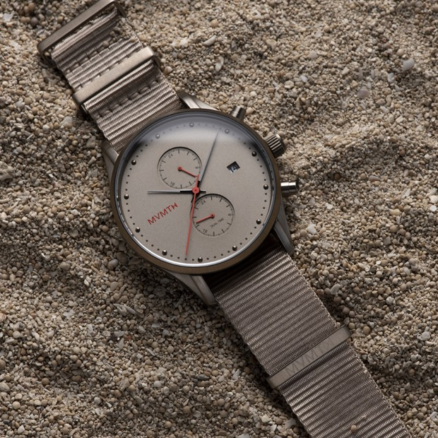Taupe nylon nato watch on a flat surface