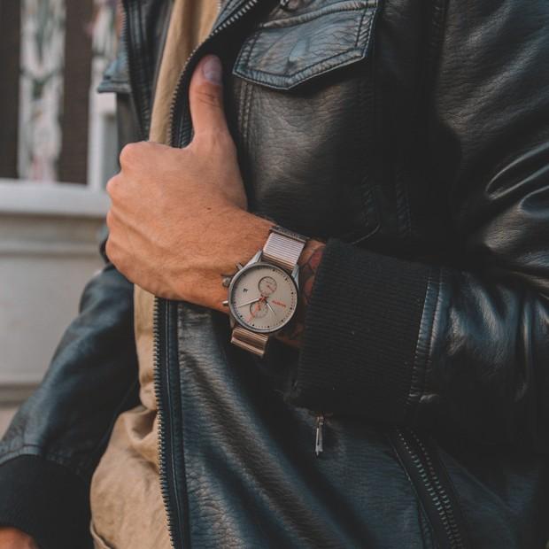 Taupe nylon nato watch on a mans wrist