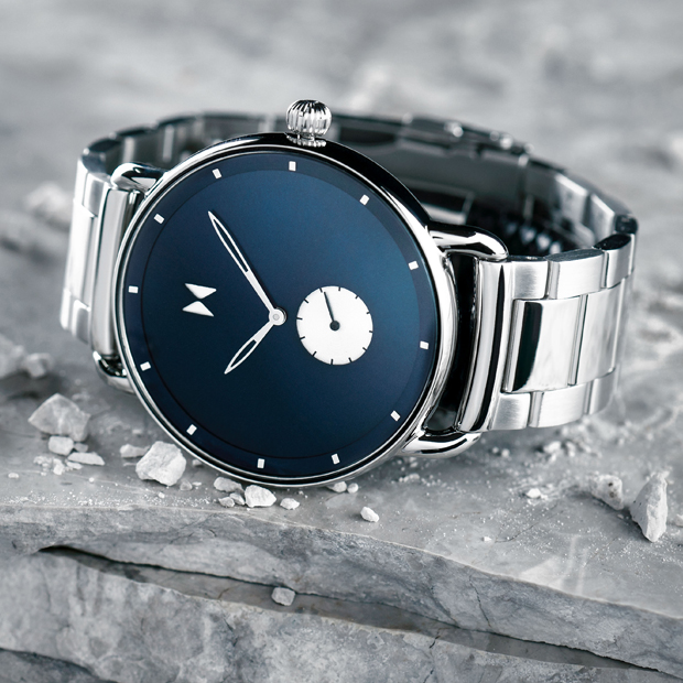 blue and silver link watch on a grey backgroun