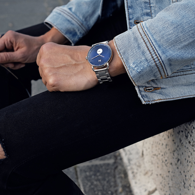 blue and silver link watch on a man's wrist