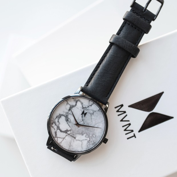 white marble and black leather watch on a white MVMT box