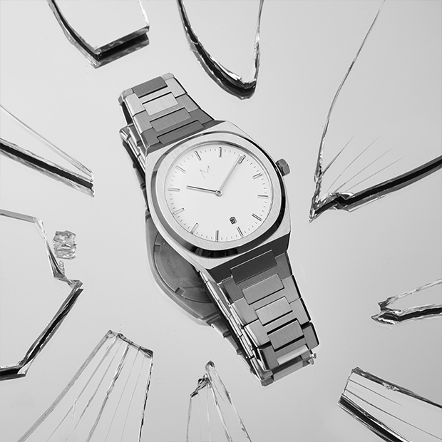 white and silver link watch on a silver surface