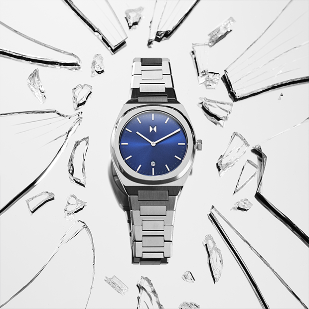 blue and silver link watch on a silver surface
