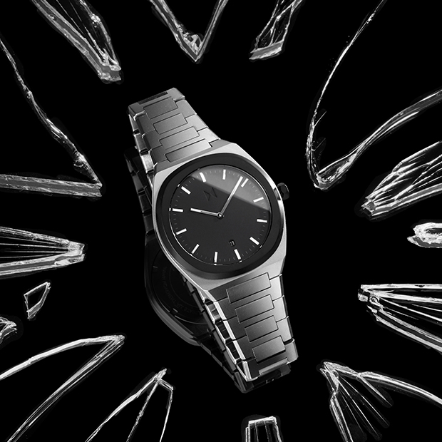 black and silver link watch on a black surface