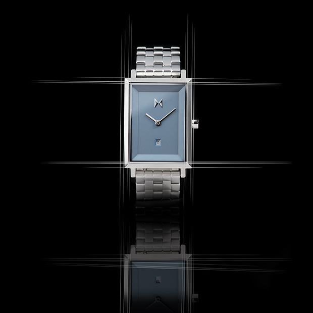 blue and silver link square watch on a black background