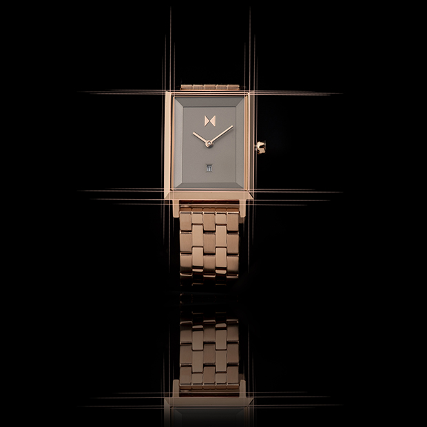 taupe and rose gold link square watch on a black background