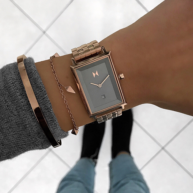 taupe and rose gold watch on a womans wrist
