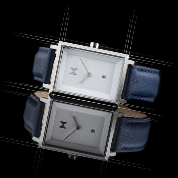 white and blue leather watch on a black surface