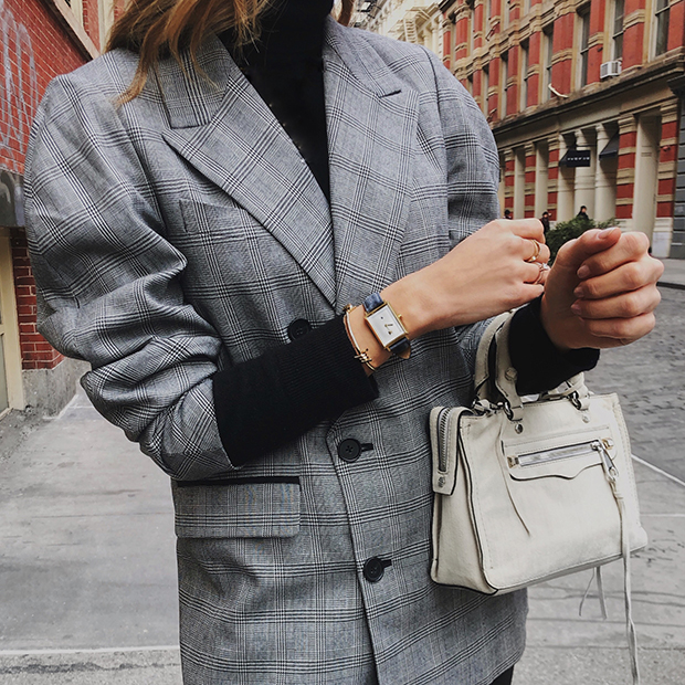 white and grey leather watch on a womans wrist