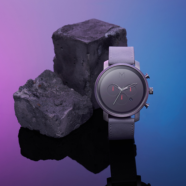 silver and grey leather watch on a purple and blue background