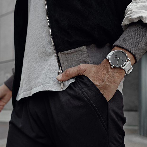 silver and grey watch on a men's wrist