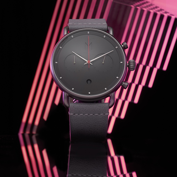 silver and grey watch on a black background