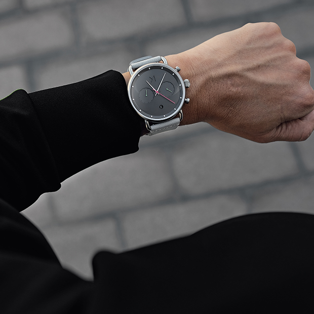 silver and grey watch on a man's wrist