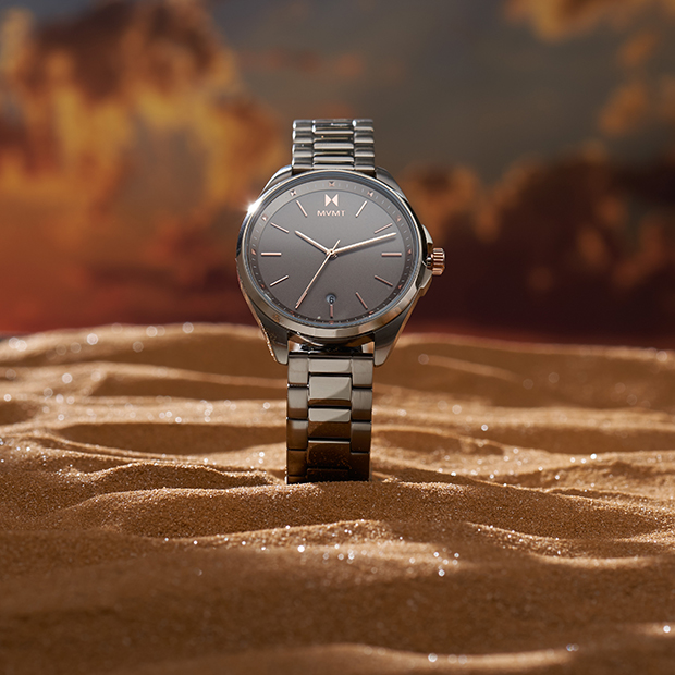 taupe and rose gold watch on desert background
