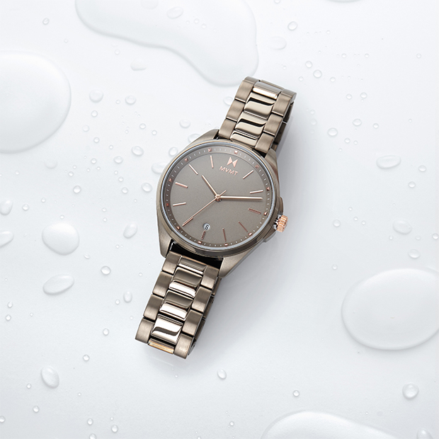 taupe and rose gold watch on background