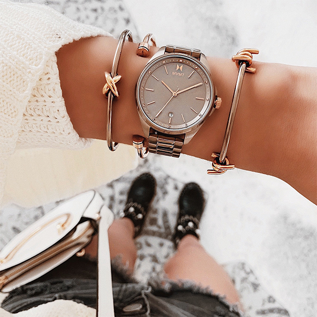 taupe and rose gold watch on women's wrist
