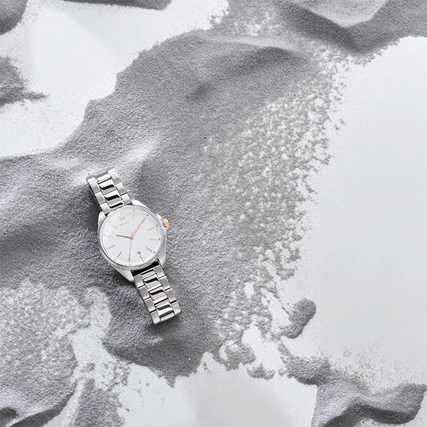 silver and rose gold watch on marble background