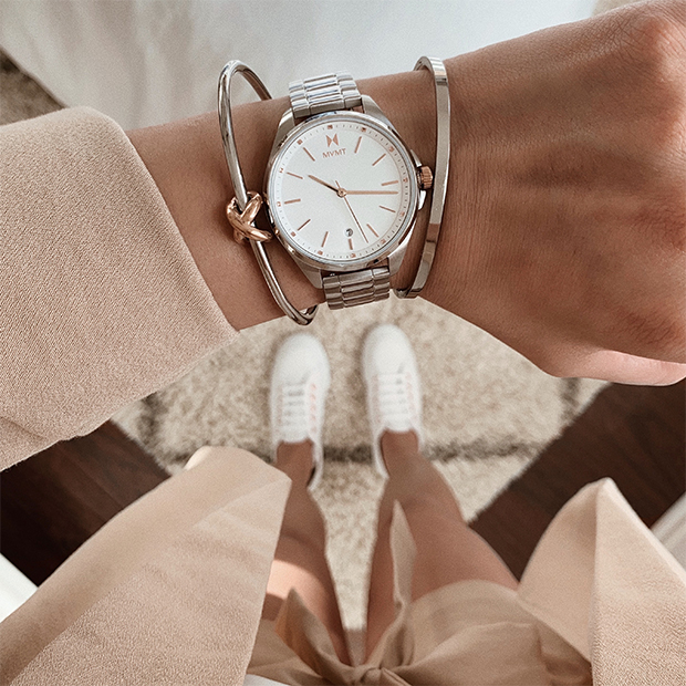 silver and rose gold watch on women's wrist