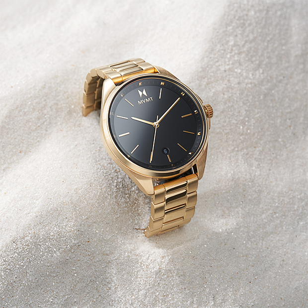 gold and black watch on background