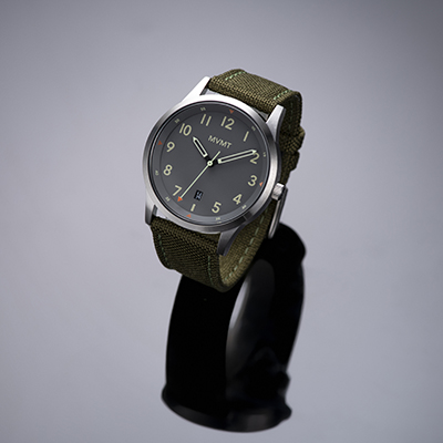 Olive green nato watch on a grey background