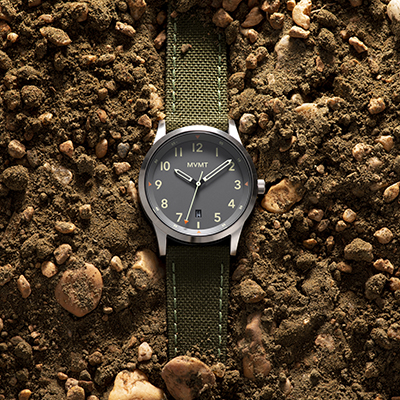 Olive green nato watch on a brown background