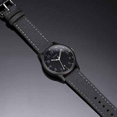 Silver and grey nylon watch on a grey background