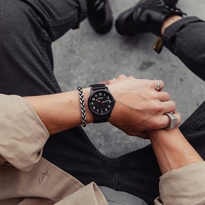 Black stainless steel watch on a mans wrist