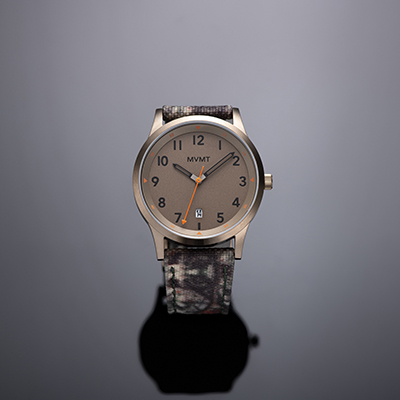 Taupe and camouflage nylon watch on a grey background