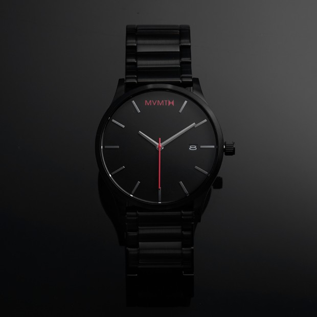 black watch with red features on a black background