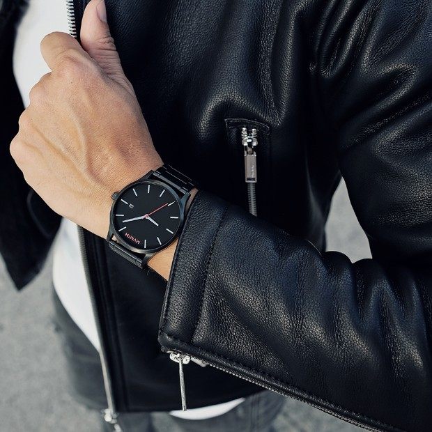 black watch with red features on a mans wrist