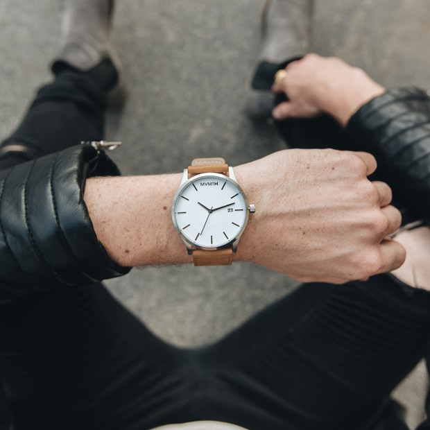 white and tan leather watch on a mans wrist