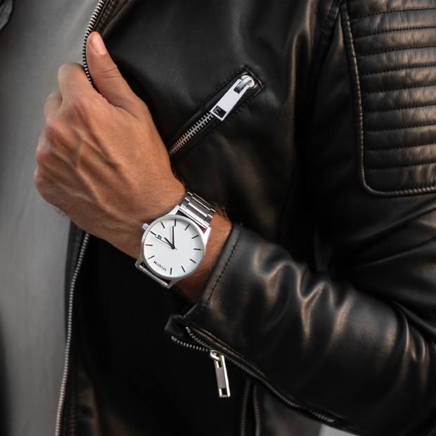 white and silver link watch on a mans wrist