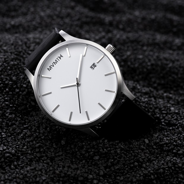 white and black leather watch on black background