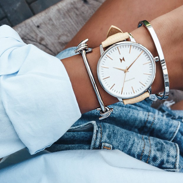 white, silver and yellow leather watch on a womans wrist