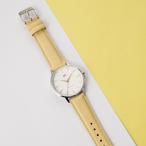 white, silver and yellow leather watch on a white and yellow surface