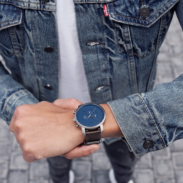 blue and brown leather watch on a mans wrist