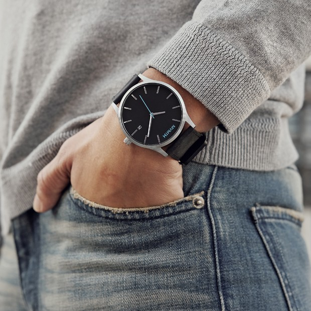black and silver leather watch on a mans wrist