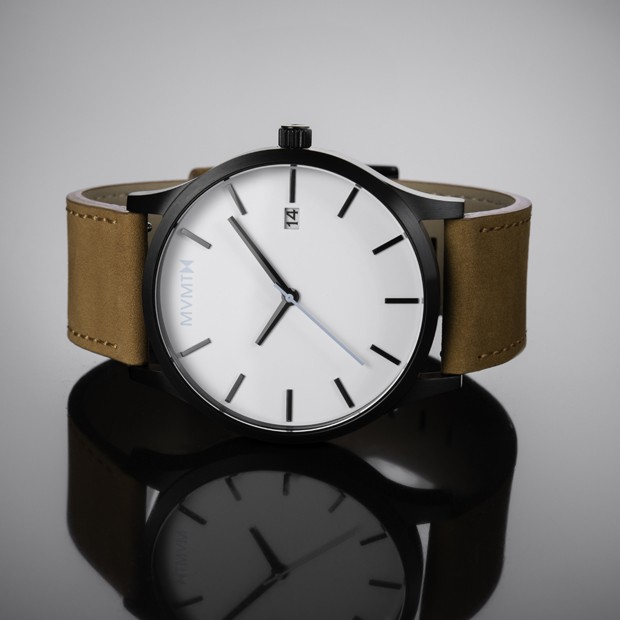 white black and tan leather watch on a reflective surface