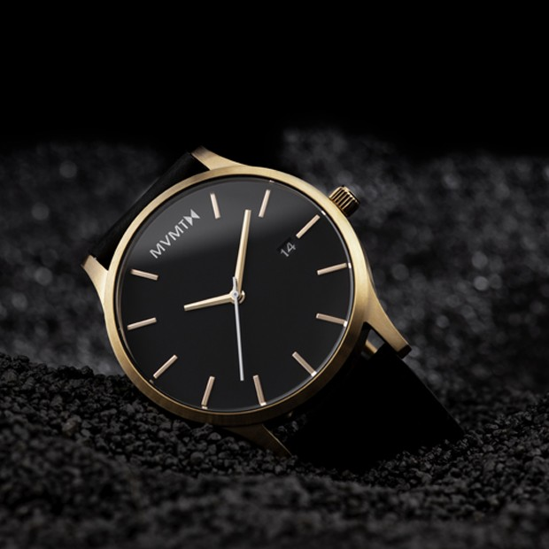 black and rose gold leather watch on a black background